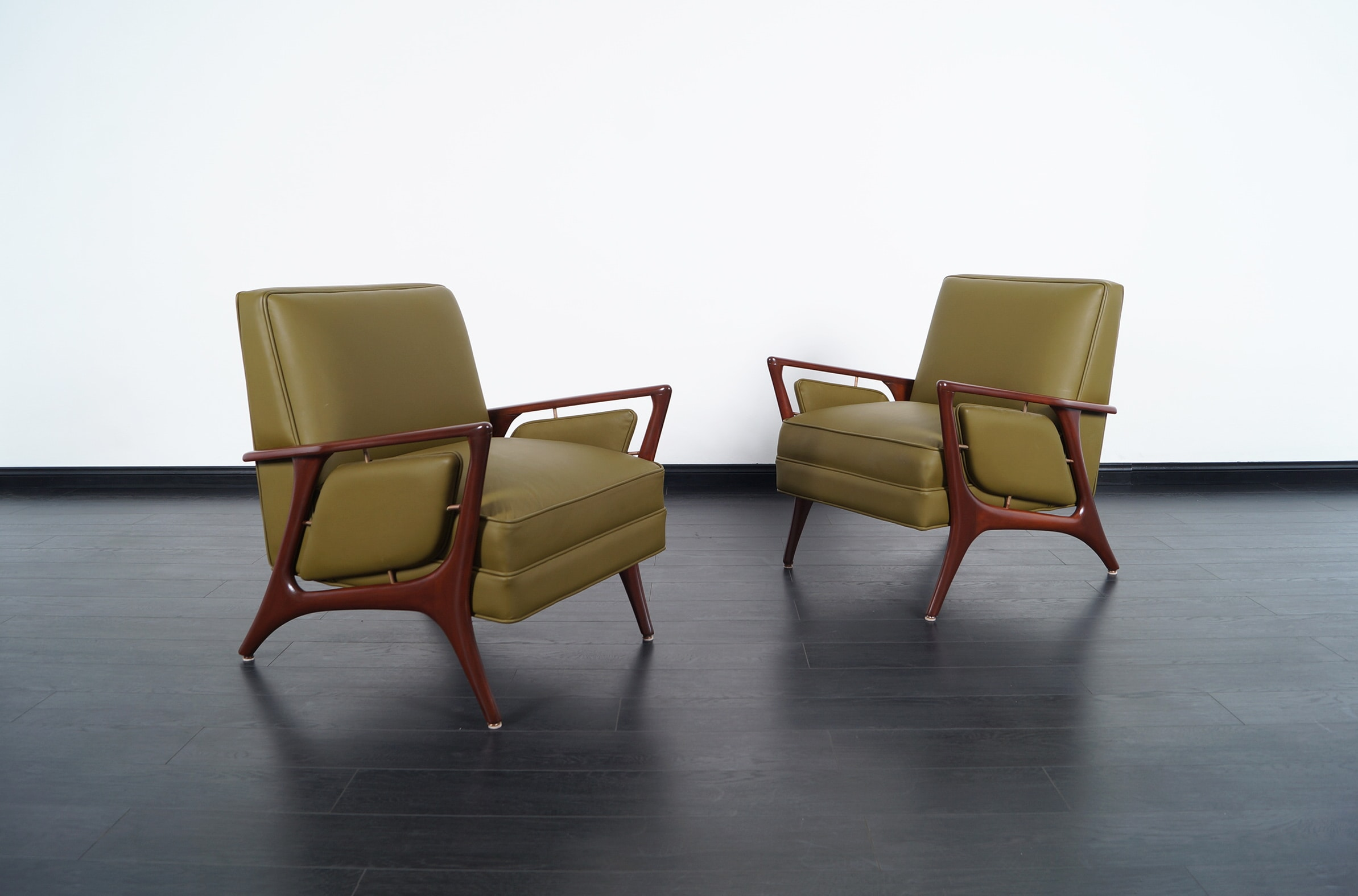 Mid Century Leather Lounge Chairs by Eugenio Escudero