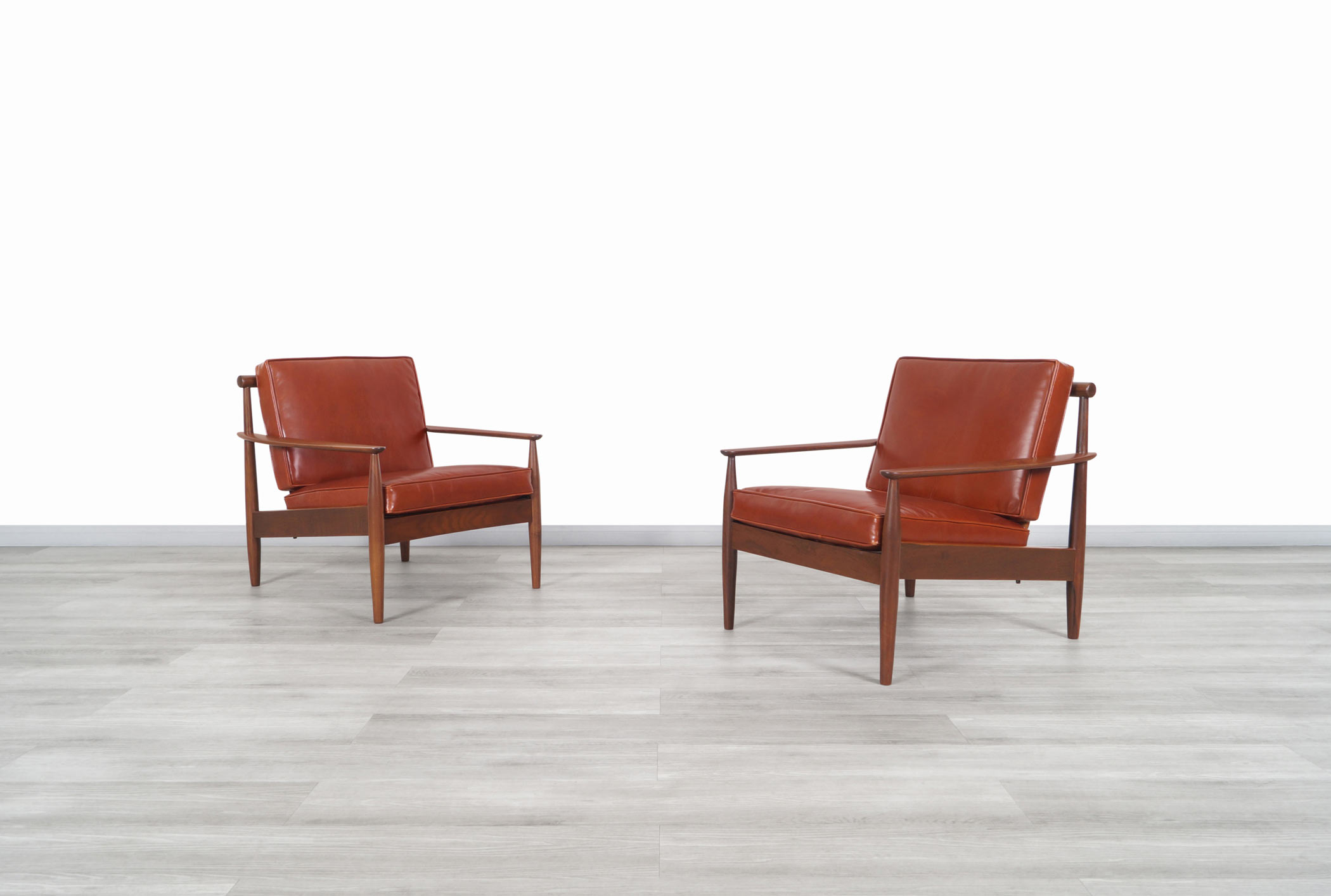 Danish Modern Leather and Walnut Lounge Chairs by Hans C. Andersen